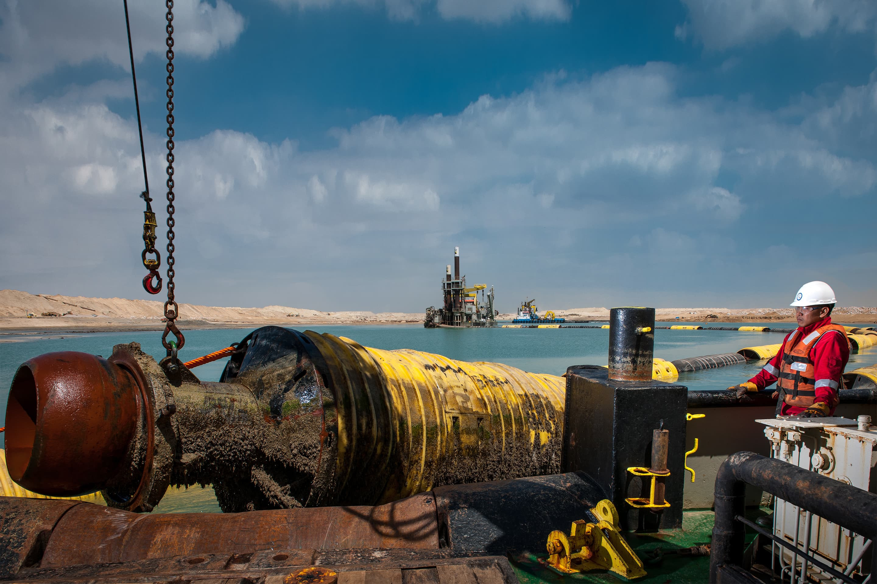 A floating pipeline being moved to another location