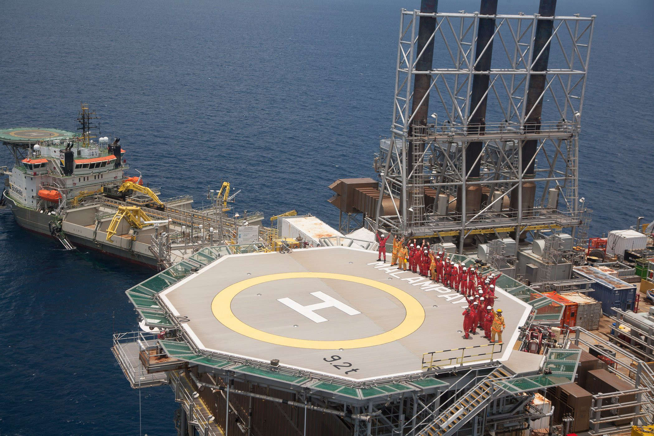 Crew on helicopter deck of the existing production platform