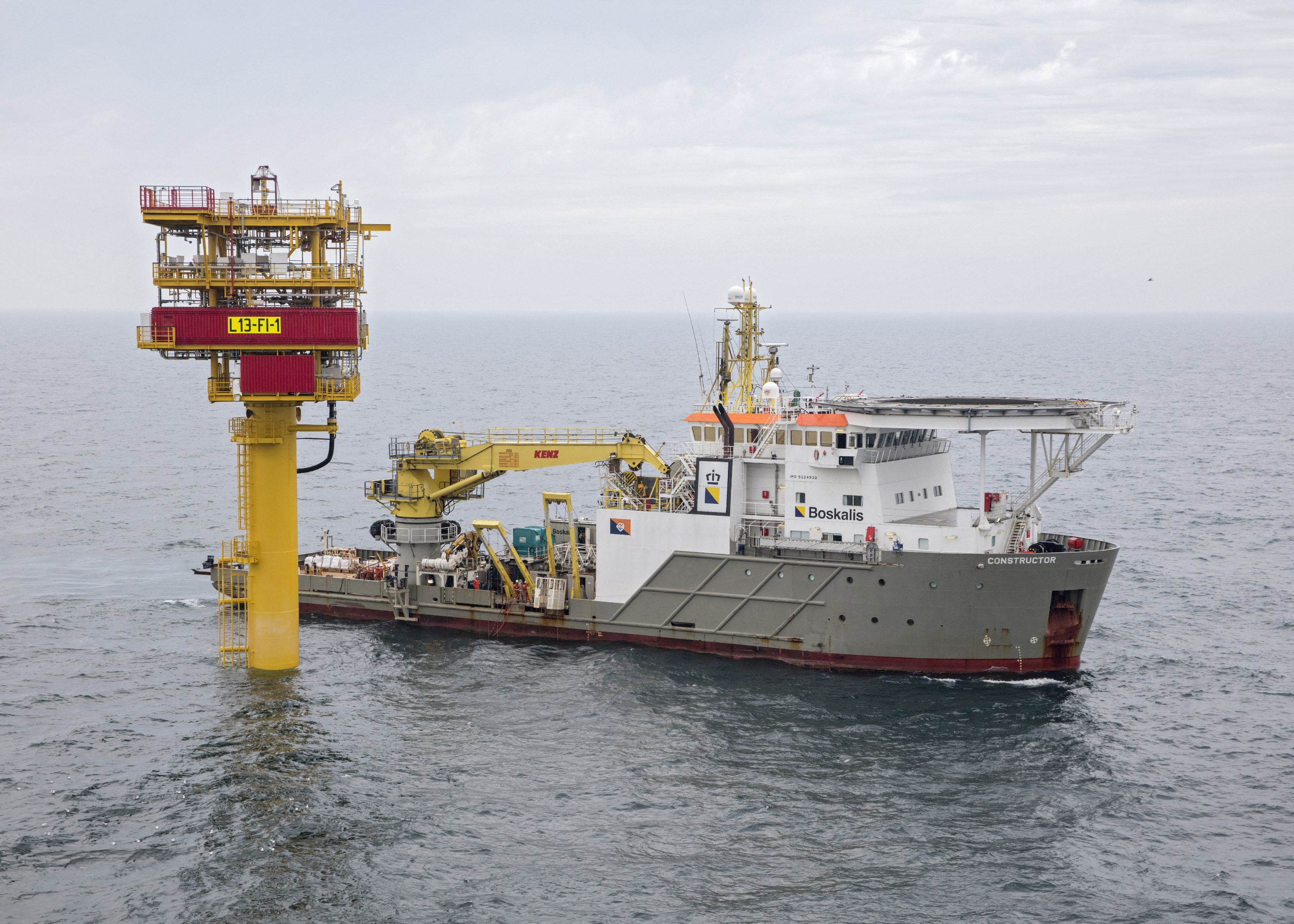 Boskalis DSV Constructor executing subsea installation works with divers at a platform in the North Sea